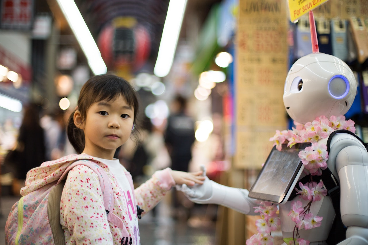 Image of young girl and robot
