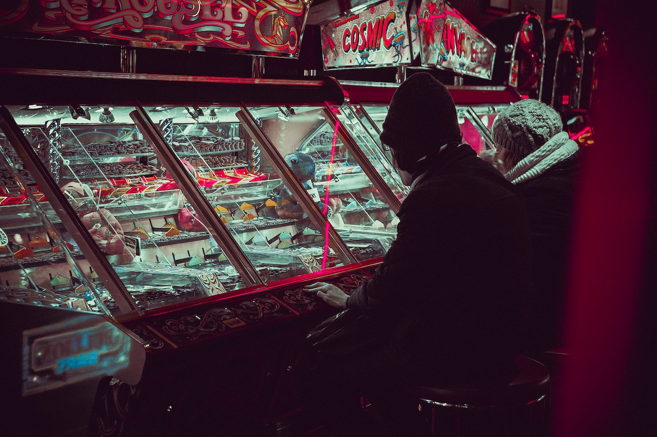 A man plays slot machines
