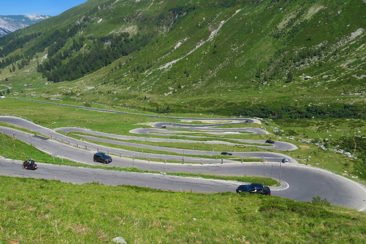 Cars climbing a winding road